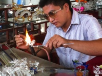 This guy was one of the many sellers on the tourist street. But his trade was much more specialized than some of the other people that were also working there. He was blowing glass and using fire to mold the glass figurines into wild, crazy things, like miniature dragons and mini-pianos. And as was the case in China, these fine pieces of work that must have taken many hours of labor cost a whopping 40 kuai, or just about 7 dollars.